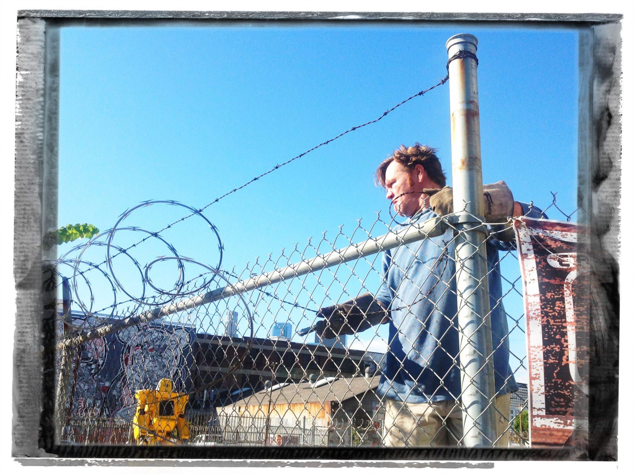 Local Artist removes razor wire - November 19, 2012