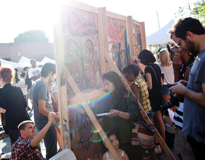 People painting at an outdoor art event