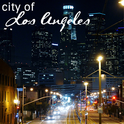 "Nightime shot of downtown Los Angeles that reads ""City of Los Angeles"""